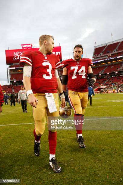 J Beathard and Joe Staley of the San Francisco 49ers talk on the field following the game against the Seattle Seahawks at Levi's Stadium on November...