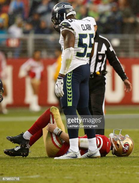 J Beathard of the San Francisco 49ers grabs at his leg after going down injured against the Seattle Seahawks at Levi's Stadium on November 26 2017 in...