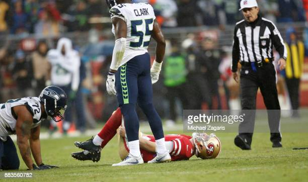 J Beathard of the San Francisco 49ers lays on the ground with a knee injury during the game against the Seattle Seahawks at Levi's Stadium on...