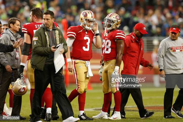 J Beathard of the San Francisco 49ers leaves the game against the Seattle Seahawks after getting injured at Levi's Stadium on November 26 2017 in...