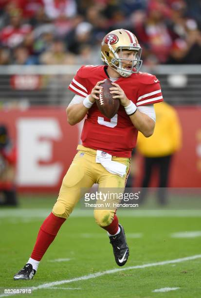 J Beathard of the San Francisco 49ers looks to pass against the Seattle Seahawks during their NFL football game at Levi's Stadium on November 26 2017...