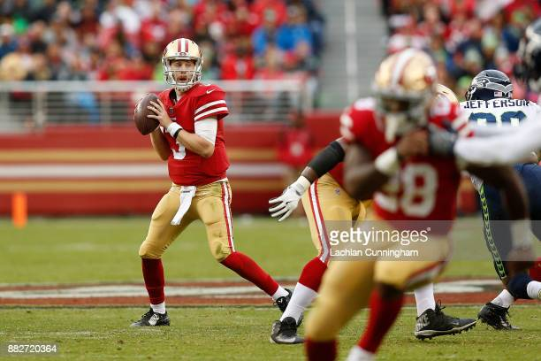 J Beathard of the San Francisco 49ers looks to pass the ball against the Seattle Seahawks at Levi's Stadium on November 26 2017 in Santa Clara...