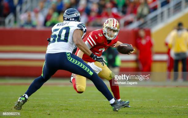 J Beathard of the San Francisco 49ers rushes out of the pistol during the game against the Seattle Seahawks at Levi's Stadium on November 26 2017 in...