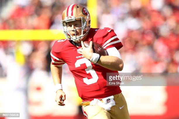 J Beathard of the San Francisco 49ers rushes with the ball against the Dallas Cowboys during their NFL game at Levi's Stadium on October 22 2017 in...