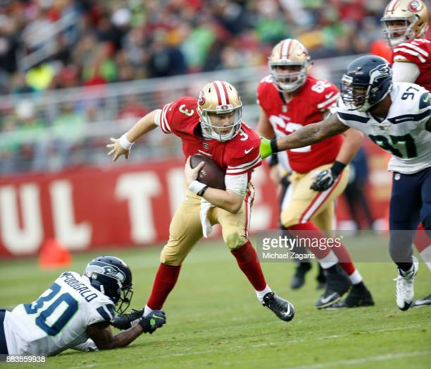 J Beathard of the San Francisco 49ers scrambles during the game against the Seattle Seahawks at Levi's Stadium on November 26 2017 in Santa Clara...