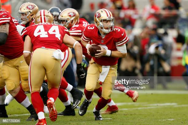 J Beathard of the San Francisco 49ers takes the snap against the Seattle Seahawks at Levi's Stadium on November 26 2017 in Santa Clara California