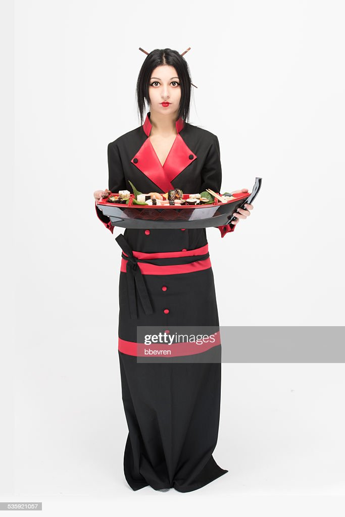 Beatifull attractive asian cook chef holding a luxury sushi dish : Stock Photo