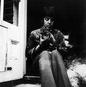 Beatle Paul McCartney sitting on the doorstep of his St John's Wood home with two kittens and an old English sheepdog 20th June 1967