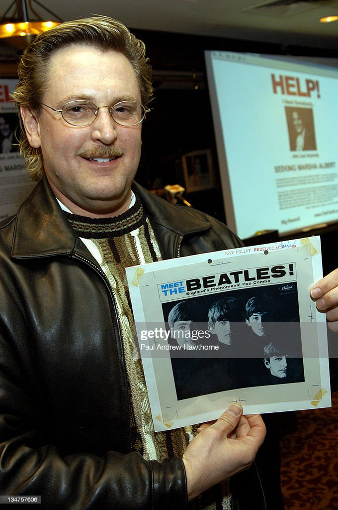 Beatles collector, Gary Hein holds the original cover art for the Beatles first album 'Meet <a gi-track='captionPersonalityLinkClicked' href=/galleries/search?phrase=The+Beatles&family=editorial&specificpeople=90369 ng-click='$event.stopPropagation()'>The Beatles</a>' in 1964.