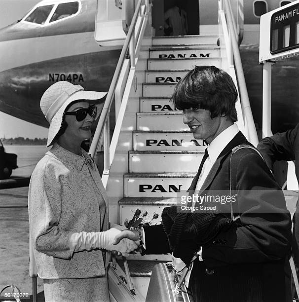Beatles drummer Ringo Starr boarding a plane at London Airport with actress Vivien Leigh 12th June 1964 Starr is flying to Australia to join the rest...
