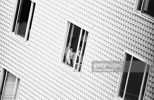 Beatles fans trying to catch a glimpse of the band during their stay in the Tokyo Hilton 1966