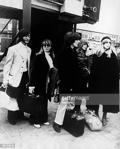 Beatles John Lennon and George Harrison leave Heathrow Airport for two months' transcendental meditation at Rishikesh in the Himalayas with the...