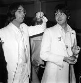 Beatles John Lennon and Paul McCartney at London Airport after a trip to America to promote their new company Apple Corps 16th May 1968 They are both...