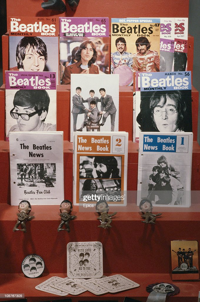 Beatles memorabilia on display including Beatles news books issued by the fan club, plastic figures of Paul, Ringo George and John and beer mats, circa 1985.
