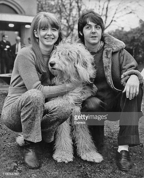 Beatles singer and musician Paul McCartney with his girlfriend Jane Asher and their Old English Sheepdog named Martha outside the Golden Gates Hotel...