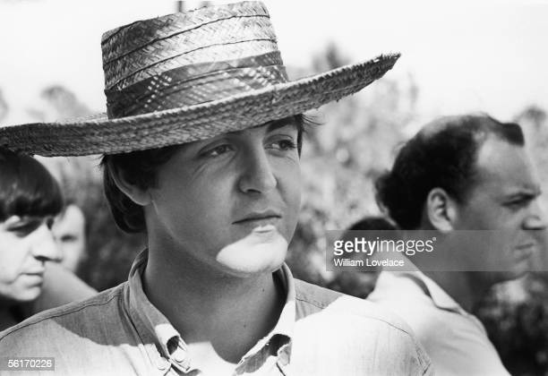 Beatles singer and songwriter Paul McCartney wearing a straw hat while filming 'Help' in The Bahamas 2nd March 1965