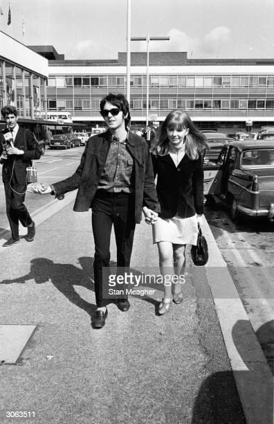 Beatles singer Paul McCartney meets his girlfriend actress Jane Asher at London Airport May 28th 1967