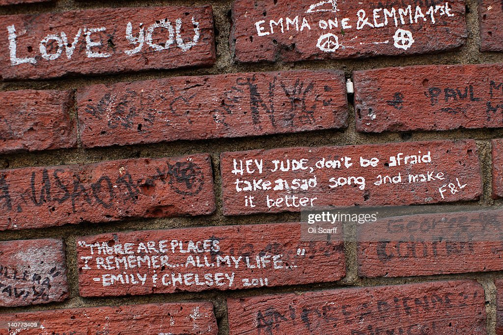 Beatles-themed graffiti on the wall of Abbey Road Studios in St John's Wood on March 5, 2012 in London, England. Abbey Road in North London has been made famous by 1960s bands such as The Beatles and Pink Floyd who recorded in Abbey Road Studios. In particular, the cover of The Beatles' 1969 album 'Abbey Road' features the band on the pedestrian zebra crossing outside the studio. The crossing has become a popular destination for Beatles fans from around the world.