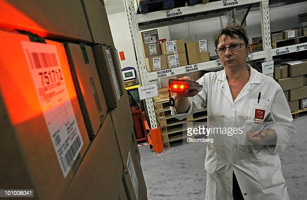Beatrice Brumeau an employee at the Johnson Controls Inc and Saft Groupe SA factory a joint venture producing Lithiumion batteries scans warehouse...