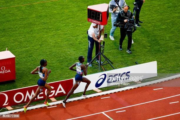 Beatrice Chepkoech and Celliphine Chespol of Kenya and Illustration Bell for the last lap during Women's 3000m Steeplechase during the Meeting de...