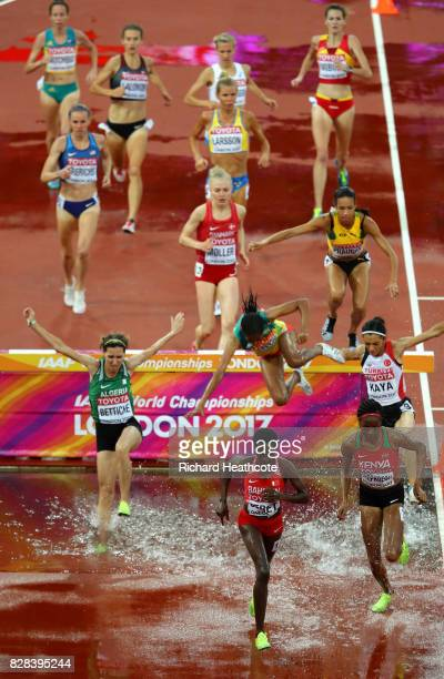 Beatrice Chepkoech of Kenya and Ruth Jebet of Bahrain compete in the Women's 3000 metres Steeplechase heats during day six of the 16th IAAF World...