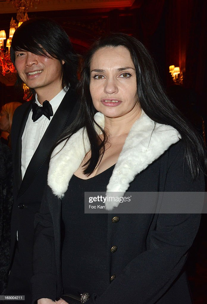 Beatrice Dalle (R) and Axel Huynh from Crazy Baby attend the 'Don't Tell My Booker' Supports La Croix Rouge Dinner - PFW F/W 2013 at the Hotel Intercontinental on March 2nd, 2013 in Paris, France.