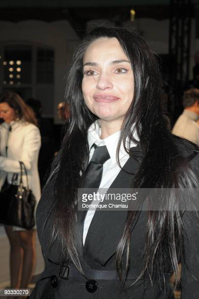 Beatrice Dalle attends the Givenchy Pret a Porter show as part of the Paris Womenswear Fashion Week Spring/Summer 2010 at Lycee Carnot on October 4...