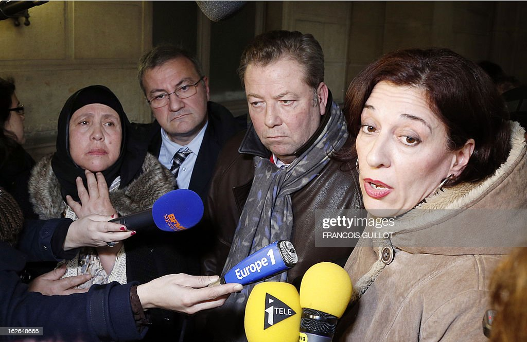 Beatrice Dubreuil (R), the lawyer of Albert Chennouf-Meyer, the father of late paratrooper Abel Chennouf killed by Islamist gunman Mohamed Merah in Montauban in March 2012, speaks to the media beside Olivier Morice (2ndR) and his client, the mother (L) of Mohammed Legouad, another victim of Merah, upon thier arrival at Paris courthouse on February 25, 2013 before meeting the investigating anti-terror judges.