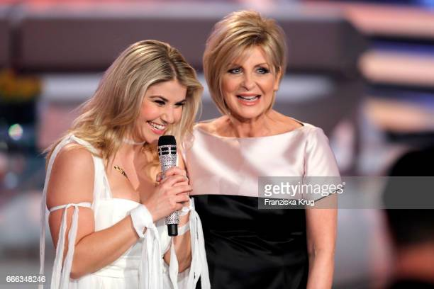 Beatrice Egli and Carmen Nebel during the television show 'Willkommen bei Carmen Nebel' on April 8 2017 in Magdeburg Germany