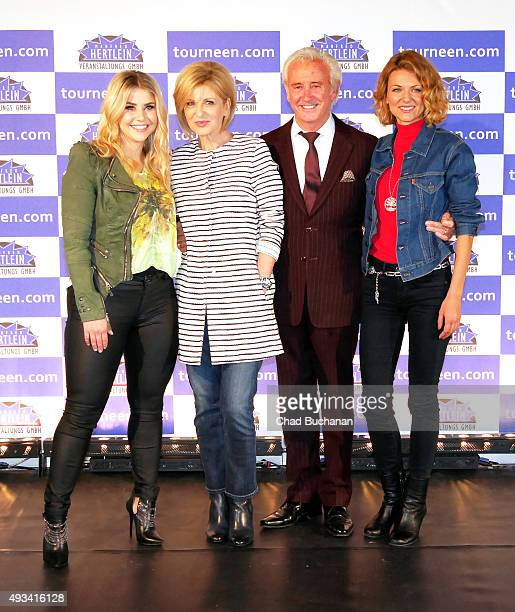 Beatrice Egli Carmen Nebel Tony Christie and Ella Endlich pose for photos at the 'Willkommen bei Carmen Nebel' Tour Press Conference on October 20...