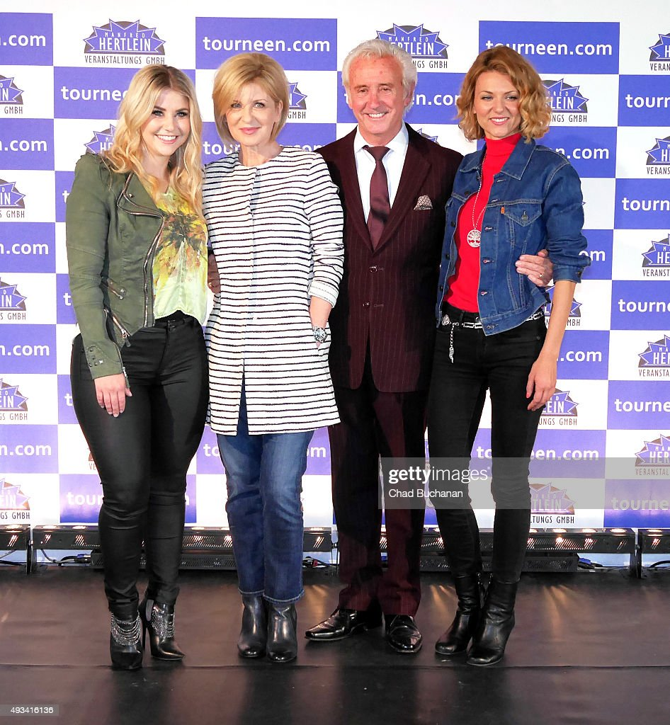Beatrice Egli, Carmen Nebel, Tony Christie and Ella Endlich pose for photos at the 'Willkommen bei Carmen Nebel' Tour - Press Conference on October 20, 2015 in Berlin, Germany.