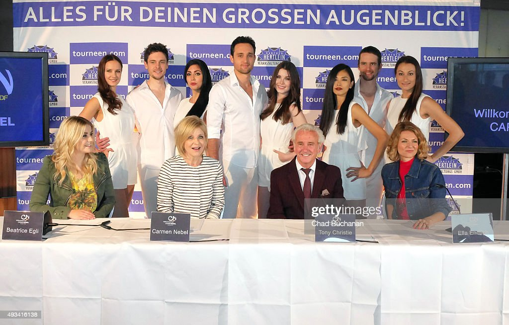 Beatrice Egli, Carmen Nebel, Tony Christie and Ella Endlich pose for photos along with performers at the 'Willkommen bei Carmen Nebel' Tour - Press Conference on October 20, 2015 in Berlin, Germany.
