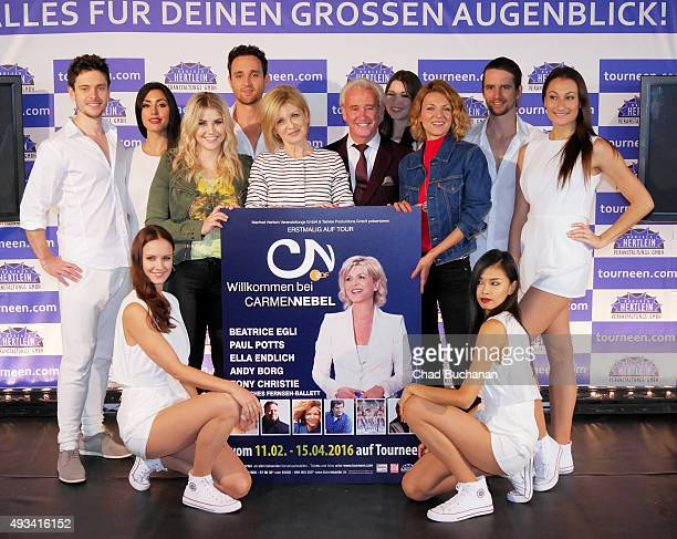 Beatrice Egli Carmen Nebel Tony Christie and Ella Endlich pose for photos along with performers at the 'Willkommen bei Carmen Nebel' Tour Press...