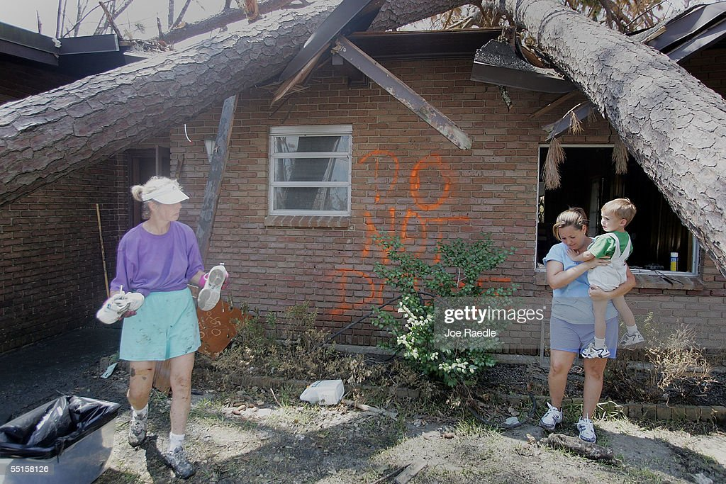 Beatrice Flair Toby Flair and Ashton Flair work on saving valuables in their home after it was damaged during Hurricane Katrina September 6 2005 in...