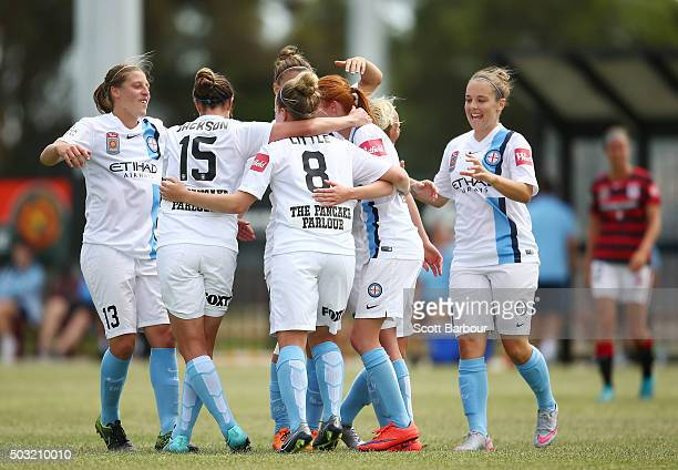 Beatrice Goad of City FC celebrates with her teammates after scoring the third goal during the round 12 WLeague match between Melbourne City FC and...