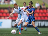 Beatrice Goad of Melbourne City contests the ball with Chloe Logarzo of the Jets during the round nine WLeague match between the Newcastle Jets and...