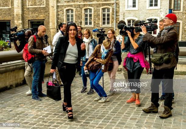 Beatrice Huret the widow of a French police officer and a former activist of the farright Front National party surrounded by journalists arrives at...