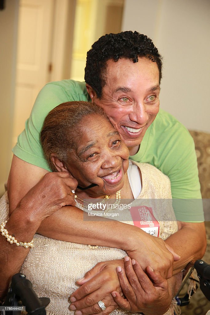 Beatrice Thomas and <a gi-track='captionPersonalityLinkClicked' href=/galleries/search?phrase=Smokey+Robinson&family=editorial&specificpeople=210698 ng-click='$event.stopPropagation()'>Smokey Robinson</a> performs at Freedom Hill Amphitheater on August 29, 2013 in Sterling Heights, Michigan.