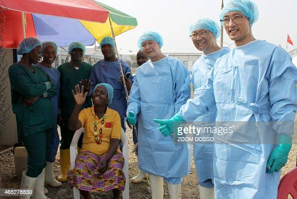 Beatrice Yordoldo the last confirmed Ebola patient poses for photographs with medical staff as she prepares to leave the Ebola treatment unit in the...