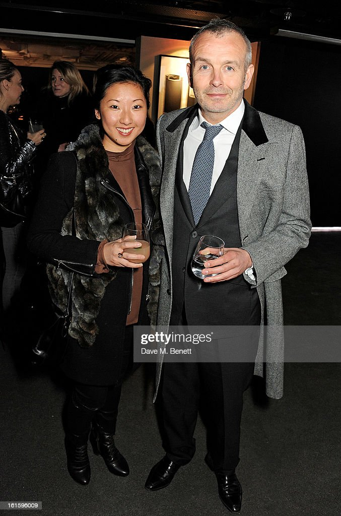 <a gi-track='captionPersonalityLinkClicked' href=/galleries/search?phrase=Beatrix+Ong&family=editorial&specificpeople=4644842 ng-click='$event.stopPropagation()'>Beatrix Ong</a> (L) and Piers Adam attend the launch of the Vertu Ti at the London Film Museum, Covent Garden on February 12, 2013 in London, England.