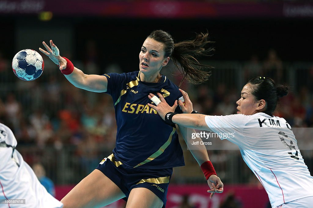 Beatriz Fernandez Ibanez #7 of Spain passes the ball against Cha Youn Kim #9 of South Korea during the Women's Handball Match on Day 15 of the London 2012 Olympics Games at Basketball Arena on August 11, 2012 in London, England.