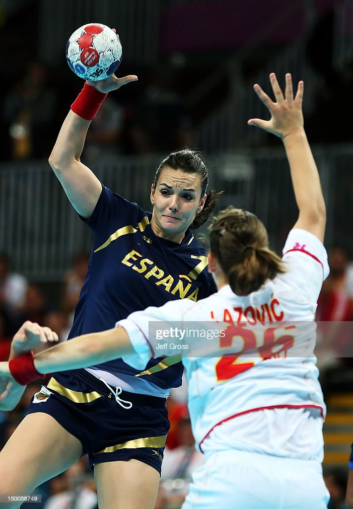 Beatriz Fernandez Ibanez #7 of Spain passes the ball over Suzana Lazovic #26 of Montenegro during the Women's Handball semifinal game between Spain and Montenegro on Day 13 of the London 2012 Olympic Games at the Basketball Arena on August 9, 2012 in London, England.