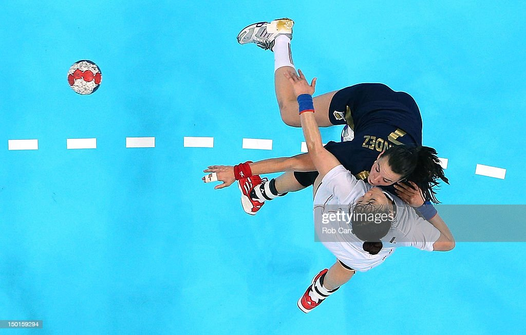 Beatriz Fernandez Ibanez #7 of Spain shoots over Eun Hee Ryu #11 of South Korea during the Women's Handball Bronze Medal Match on Day 15 of the London 2012 Olympics Games at Basketball Arena on August 11, 2012 in London, England.