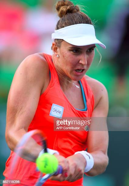 Beatriz Haddad Maia of Brazil hits a return against Richel Hogenkamp of the Netherlands during their women's singles semifinal match at the WTA Korea...