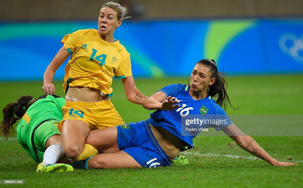Beatriz of Brazil collides with Lydia Williams and Alanna Kennedy of Australia during the second half of the Women's Football Quarterfinal match at...
