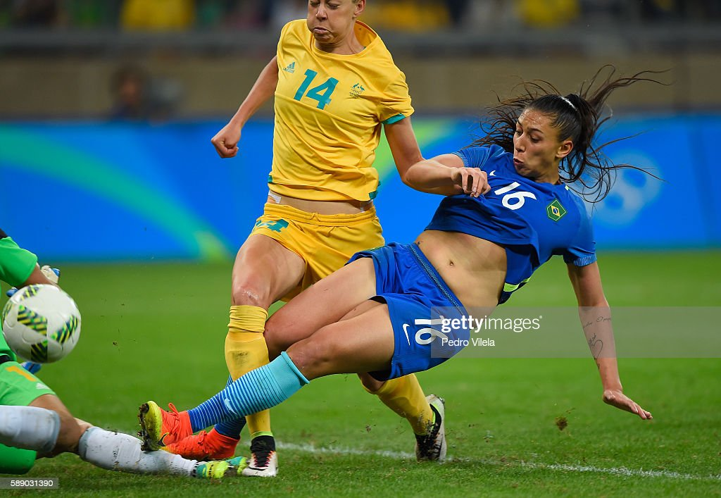 Beatriz of Brazil slides as she shoots against Lydia Williams and Alanna Kennedy of Australia during the second half of the Women's Football...