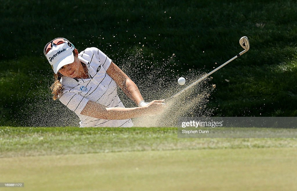 <a gi-track='captionPersonalityLinkClicked' href=/galleries/search?phrase=Beatriz+Recari&family=editorial&specificpeople=2259558 ng-click='$event.stopPropagation()'>Beatriz Recari</a> of Spain hits out of a bunker on the 17th hole during the third round of the Kraft Nabisco Championship at Mission Hills Country Club on April 6, 2013 in Rancho Mirage, California.