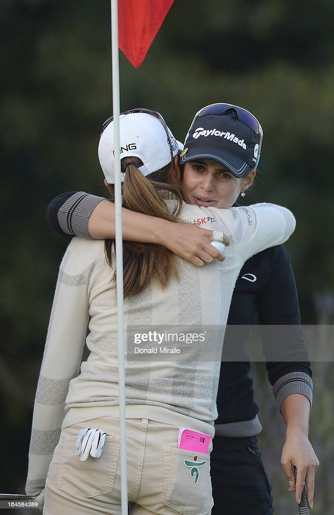 Beatriz Recari of Spain hugs I.K. Kim of South Korea after her winning putt en route to her -9 under par, 2-hole playoff victory during the Final Round of the LPGA 2013 Kia Classic at the Park Hyatt Aviara Resort on March 24, 2013 in Carlsbad, California.