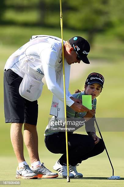 Beatriz Recari of Spain talks with her caddie during the first round of the 2013 North Texas LGPA Shootout at the Las Colinas Country Club on April...