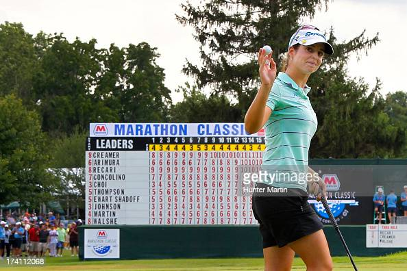 Beatriz Recari of Spain waves to the crowd after finishing her round with a birdie on the 18th hole during round three of the Marathon Classic...